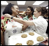 Winning contestant Patricia Walls receives congratulations from fellow bakeoff contestants, Stacey Blisset Boyd (right) and Pamela Parker (center) after she won 1st prize in the chocolate chip cookie bakeoff. YWCA Chocolate Chip cookie bakeoff took place at the Stratford University Culinary Arts in Falls Church.